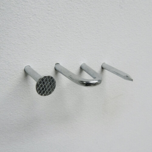 A nail going in out in out of the wall